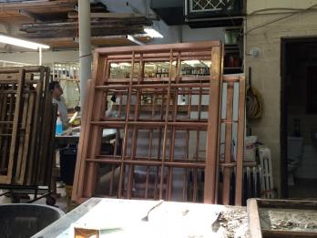 Stripped copper clad wood windows in the restoration shop
