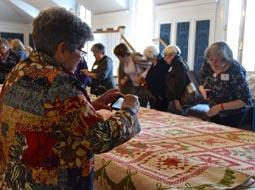 """Eye Opening"" symposium participants took a break from scholarly papers to get up close  with other quilts from the DAR Museum collection, one of the largest in the United States."