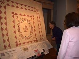 "Visitors take in the quilts at the ""Eye on Elegance"" opening October 2014."