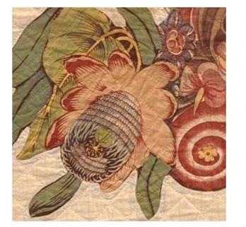 You can zoom in on the quilts to see high-resolution details. The flower on the right is in the center basket on this 1830s quilt by Anna Garnhart.