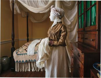 Short gown with John Guest's label in the collar, possibly worn by his sister, Elizabeth Guest Evans (or possibly Margaret Evans Chandler, his niece). Head wrap, as worn by African- American women, both enslaved and free.