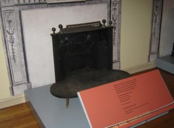 A cast iron heating stove made in the 1810s.
