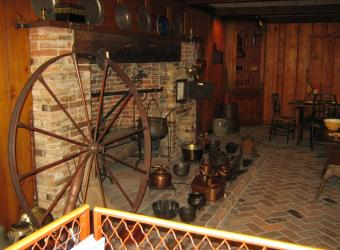 The Oklahoma period room displays many accessories for cooking on the open hearth.
