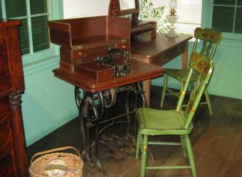 A sewing machine in the Texas period room dating between 1868 and 1875.