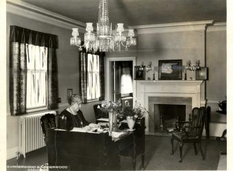 Mrs. Minor at the desk in the President General's office in the 1920s