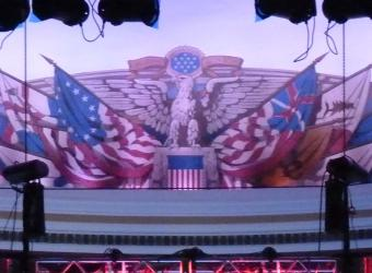 Above the stage in Constitution Hall, there is a beautiful eagle on the wall