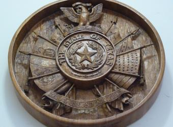 This beautiful detailed wood Texas state seal, which hangs above the Texas Period Room, showcases an eagle at the top